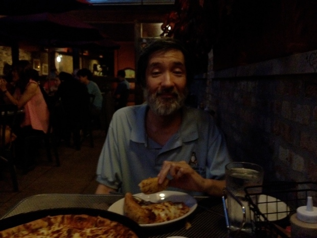 My brother Jeff, polishing off a slice of deep dish pizza at Medici's in Hyde Park, Chicago (Photo: DY, 2014)