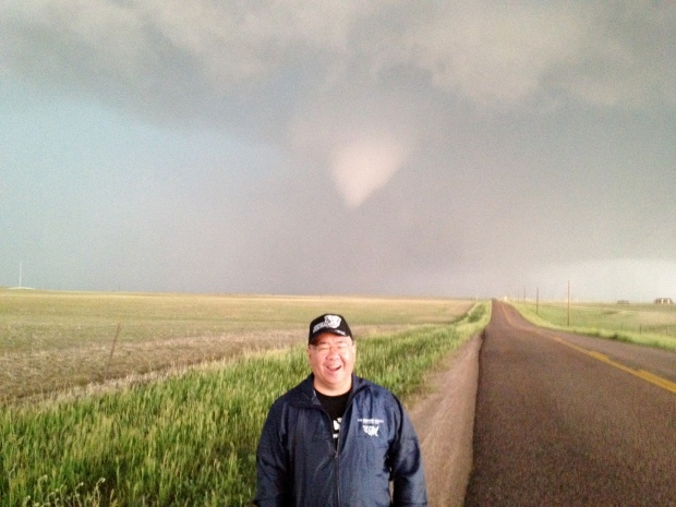 That's a funnel cloud lowering behind me in Colorado, summer 2012.
